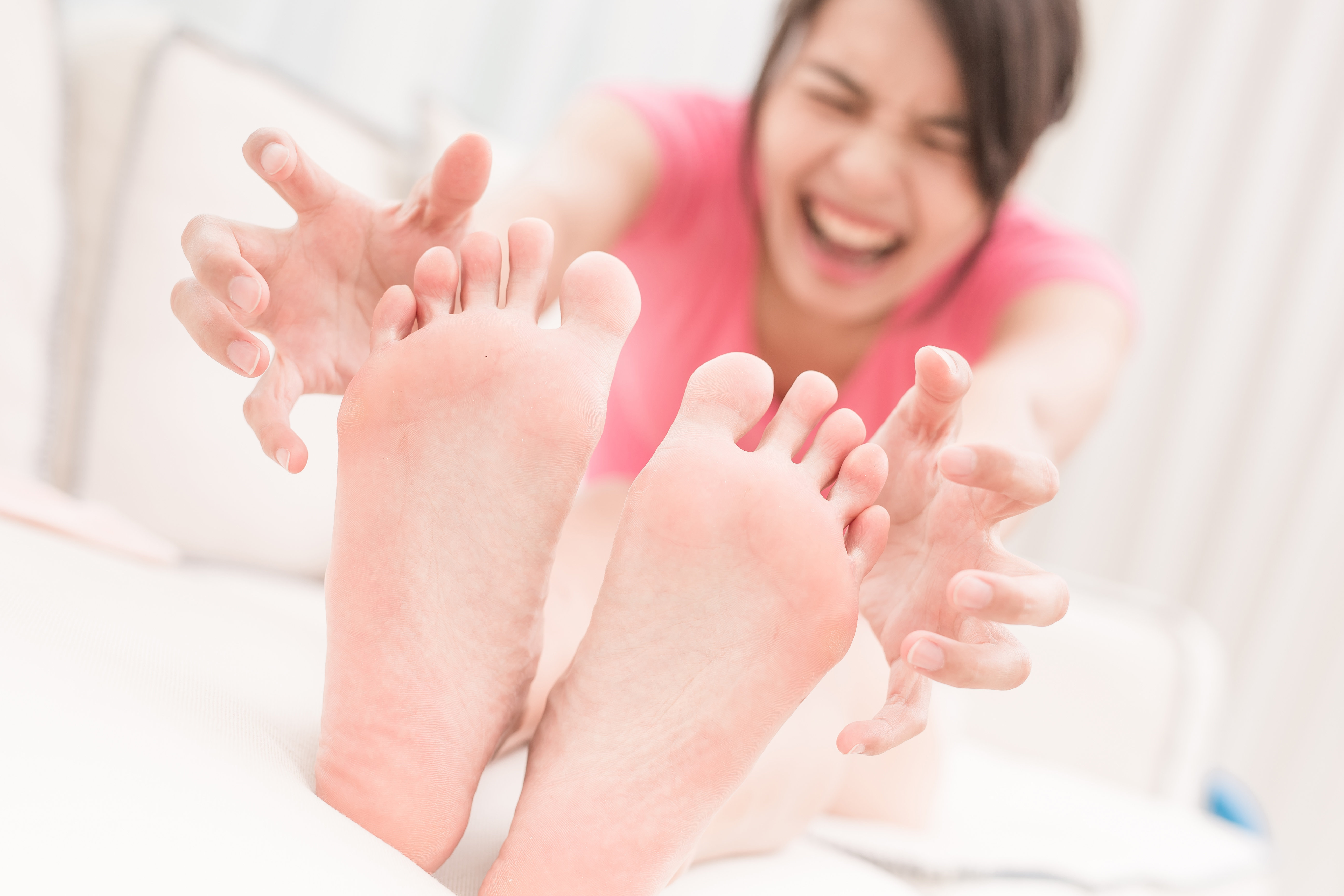 Woman in room with painful feet